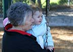 Grandma and me on the swings